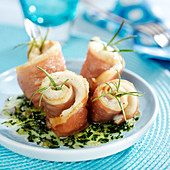 Rolled sole fillet and raw ham with rosemary, parsley sauce