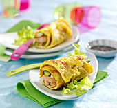 Omelette rolls garnished with shrimps and surimi crab