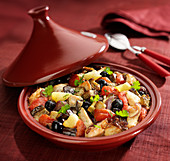 Chicken, eggplant, tomato,confit citrus and black olive Tajine