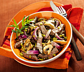 Thinly sliced beef with mushrooms, gherkins and red onions