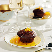 Small chocolate and orange cake, honey and salted-butter sauce