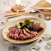 Magrets de canard in walnut crust, grapes and chestnut puree