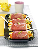 Bayonne ham rolls garnished with celeriac, apple and mimolette sticks