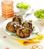 Egg plant, goat's cheese and raw ham parcels