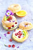 Small donuts with cream and fresh fruit