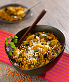 Orange lentil dal with vegetables and coconut