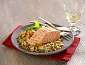 Piece of salmon with two types of lentils