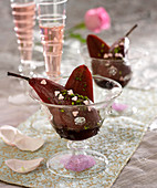 Pears poached in red wine with cardamom and pistachios