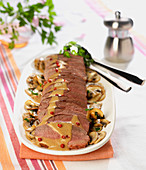 Magret de canard,creamy Cognac and pink pepper sauce, pan-fried button mushrooms