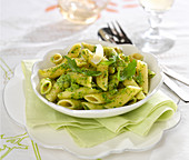 Penne with rocket lettuce and pea cream sauce