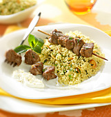 Grilled lamb brochette, semolina with mint and almonds,yoghurt sauce