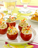 Tomatoes stuffed with fromage frais, tuna, tortillas and avocado