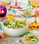 Grated courgette and carrot salad with mint and crumbled goat's cheese
