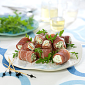 Bayonne raw ham rolls garnished with cream cheese and mint