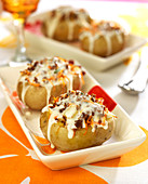 Baked potatoes stuffed with ground beef, grated carrots and Cancoillotte