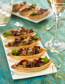 Magret de canard, dried fig and onion Périgourdine tartlets
