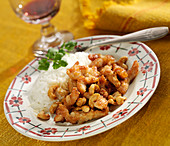 Thinly sliced chicken with cashews, plain basmati rice