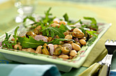 White haricot bean, mussel, red onion and rocket lettuce salad