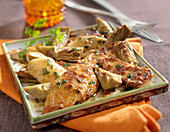 Veal escalopes with baby artichokes