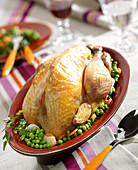 Roasted guinea-fowl with peas