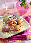 Raw ham rolls garnished with grated carrots and Beaufort, white cabbage salad