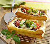 Ground beef, mozzarella, tomato, broccoli and basil flaky pastry tartlets