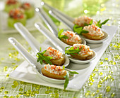 Ratte potatoes stuffed with fromage blanc and grated surimi crab