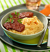 White haricot bean mash with paprika and pan-fried chorizo