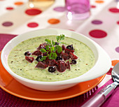 Cream of courgette soup with blackcurrants