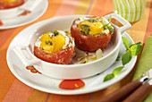Eggs baked in tomatoes with basil pesto