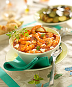 Shrimps flambeed in Cognac with tomato sauce and feta crumbs