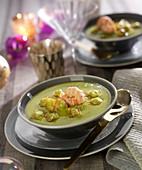 Cream of split pea soup with langoustine raviolis