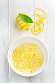 Bowl of sliced lemons in water
