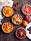 Assortment of small summer fruit pies