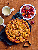 Summer fruit pie decorated with pastry hearts