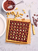 Praline ganache and hazelnut cram square tart