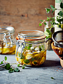 Jars of mozzarella balls marinated in oil and aromatics
