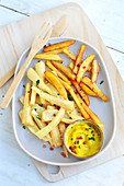Potato chips and parsnip chips,curry mayonnaise