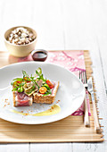 Red tuna tatakis coated in grilled sesame seeds,cherry tomatoes, broad bens and artichokes