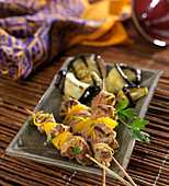 Lamb and orange brochettes with grilled aubergines