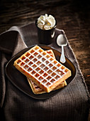 Brussels waffles sprinkled with icing sugar