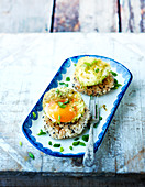 Rice patty topped with a soft-boiled egg coated with coriander and gomasio