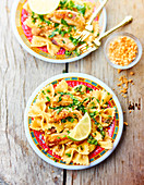 Farfalle and chicken wok with peanut-lemon sauce