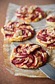 Thin apple, beet and blue cheese tartlets