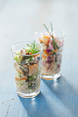 Verrine of mackerel tartar and smoked pollack with crispy vegetables