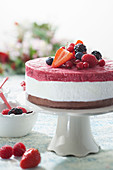 Chocolate, coconut and cherry-cardamom ice cream cake with fresh red fruits