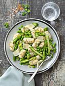 Gnocchis with herbs, peas, asparagus and pecorino