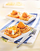 Spaghetti nest in tomato sauce and scamorza fritters