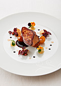 Pan-fried foie gras with confit mirabelle plums, pansies and purple basil Jean-Michel Eblin