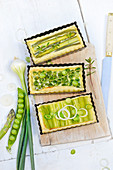 Small green leek, pea and asparagus pies